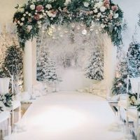 all-white-wedding-ceremony-space-with-fir-trees-and-hanging-ornaments-480x376